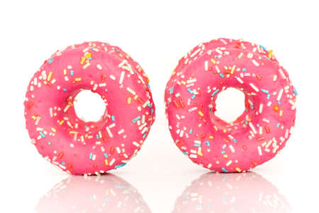 pink donuts on a white background photo