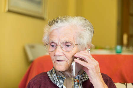 grandmother calling by phone for business Stock Photo