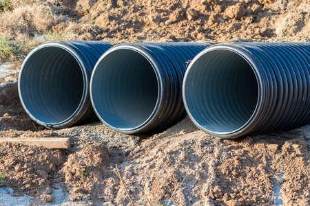 under ground: drain pipes buried under ground