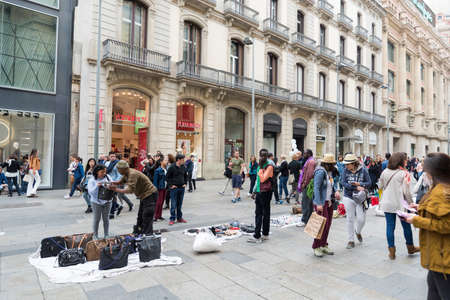 immigrants: immigrants illegally selling products in Barcelona, Spain on 25042015