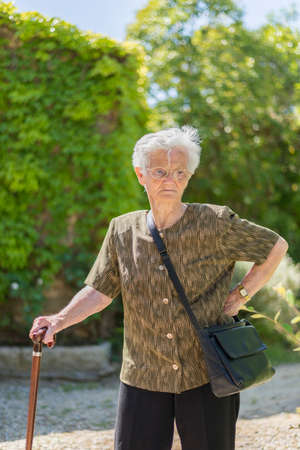 portrait of an old woman surrounded by nature