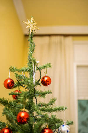 Christmas tree with hanging balls Stock Photo