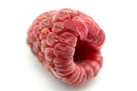 red raspberries on a white background