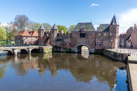 typically dutch: Medieval town wall Koppelpoort and the Eem river in Amersfoort, Netherlands
