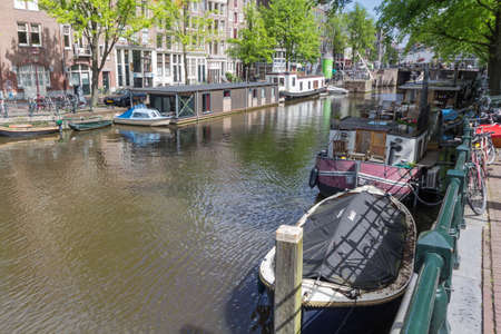 Canals of Amsterdam capital city of the Netherlands with its local boats and bridges