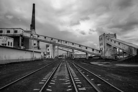 conveyor rail: Abandoned railway industrial power complex with its haunted landscape