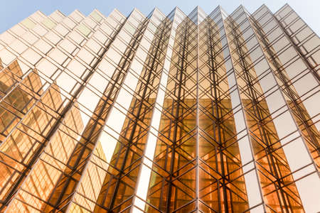 Gold colour office building tower facade  in business center