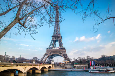 Eiffel Tower and its blue background in Paris, France Editorial