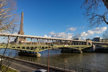 Eiffel Tower and Paris metro bridge with its blue sky