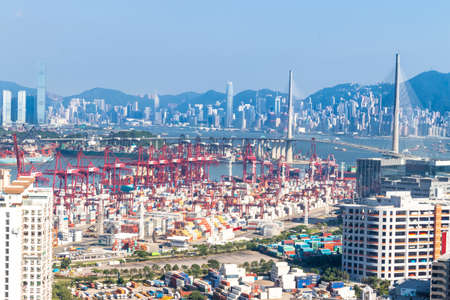 Hong Kong aerial view with its ports and sea commerce trading
