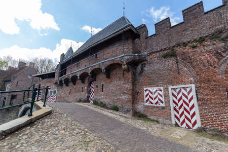 Medieval town wall Koppelpoort and the Eem river in Amersfoort, Netherlands Archivio Fotografico - 105962698