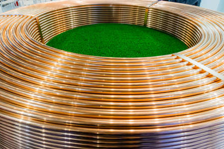 Copper trading tube coils at stock exchange Stock fotó
