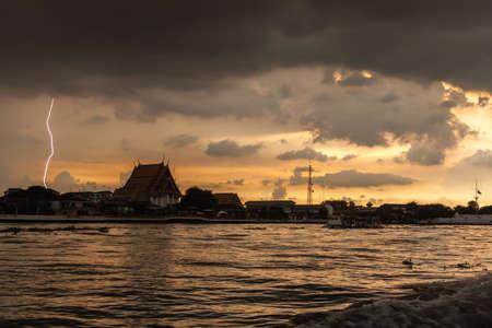 Bangkok summer lightning on the river at sunset Фото со стока