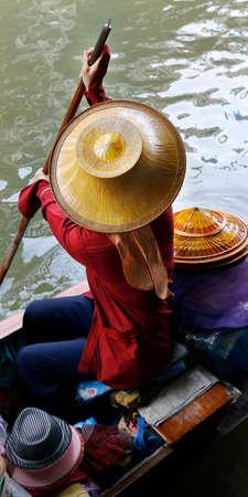 Seller on boat, floating market, Thailand