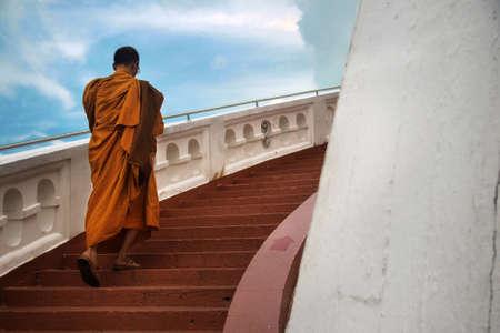 Monks climbing stairs Stok Fotoğraf