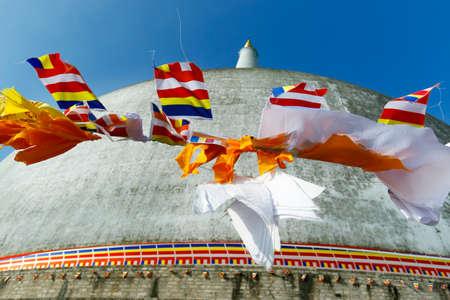 buddhist flag on ruwanwelisaya stupa, in anuradhapura historical park, sri lanka