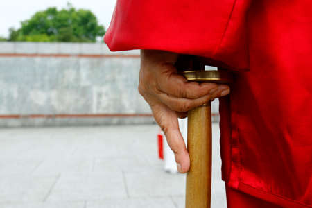 Hand holding sword during tai chi in Shanghai, China