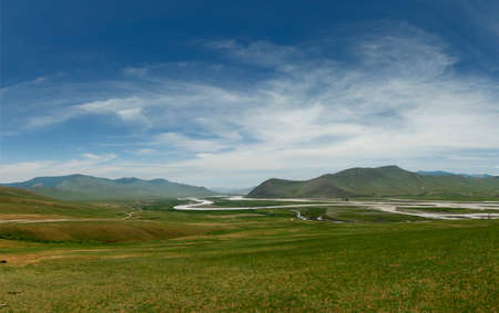 view of grassland and river in the steppe of Mongolia