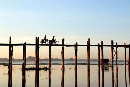 people walking on a bath bridge at Mandalay, Myanmar