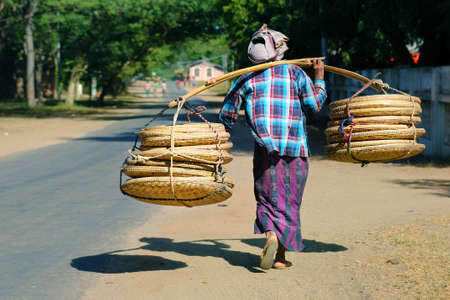 street seller, carrying basket in bamboo-rattan