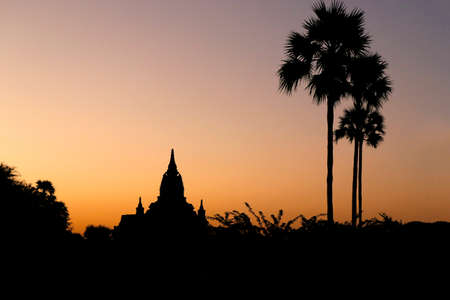 Sunset in buddhist temple, stupa, in the historical park of Bagan, Myanmar