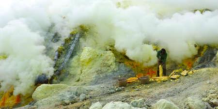 SMOKE OF SULFUR ON KAWAH IJEN VOLCANO IN JAVA ISLAND-INDONESIA