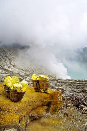 BASKET OF SULFUR ON KAWAH IJEN VOLCANO IN JAVA ISLAND-INDONESIA