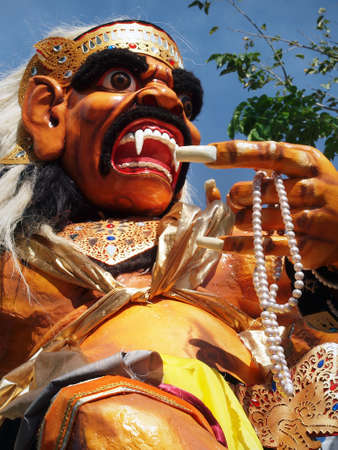 Ogoh ogoh, traditional mask-statue of bad spirit, during nyepi carnival parade in Bali - Indonesia