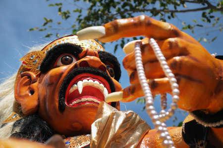 Ogoh ogoh, traditional mask-statue of bad spirit, during nyepi carnival parade in Bali - Indonesia