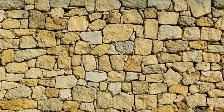 close up of wall of stone in the south of france