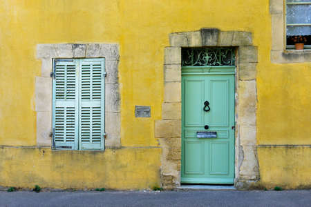 facade of mediterranean building with colorful shutter and door 스톡 콘텐츠
