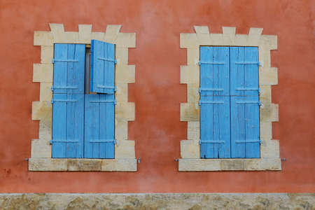 facade of mediterranean building with colorful shutter