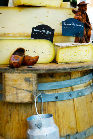 assortment of tomme of ewes sold in market in provence, france-with text ewes milk -from savoy, truffed