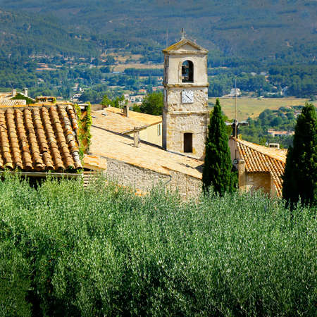 church in the middle of mediterranean village in the south of france