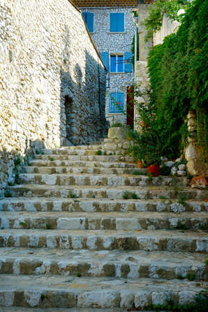street and stairs of mediterranean village with stone wall Reklamní fotografie
