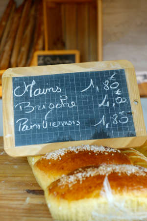 french pastries, bun, sold in bakery with text, brioche, hand, vienner pastry Stock fotó