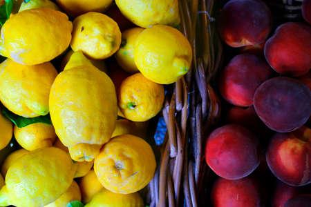 assortment of fruit sold in market in provence, france-lemon and peach Reklamní fotografie