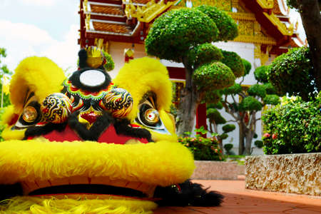 yellow chinese dragon doll in buddhist temple
