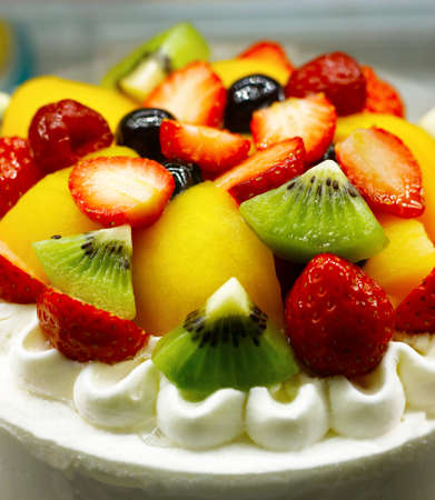 close up of fruit cake with whipped cream
