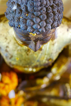 head of statue of buddha, in buddhist temple in thailand