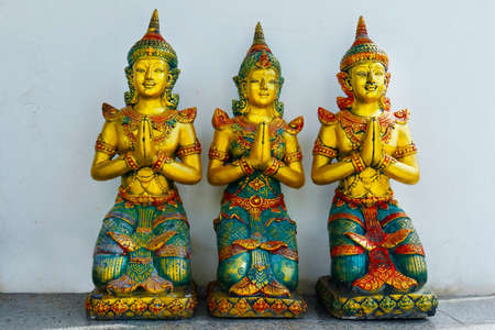 3 statues of buddha, in buddhist temple in thailand
