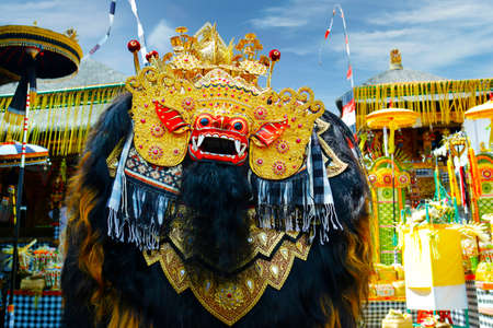 Wooden carved mask of Barong used for ceremonies in Hindu temple in Bali-Indonesia