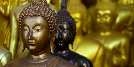 close up of head of statue of buddha, in buddhist temple, with golden color Stock fotó