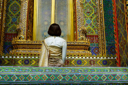woman with traditional clothes in the buddhist temple rachabopit in the city of bangkok -thailand Stock fotó
