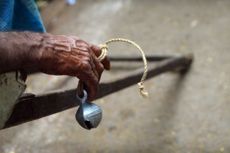 hand of rickshaw puller with bell, in the street of Kolkata -India