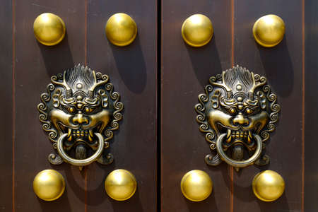 door handle with lion design in buddhist chinese temple door