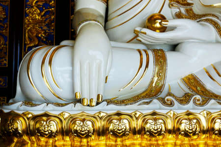 Close up of hand of buddhist statue, in buddhist temple