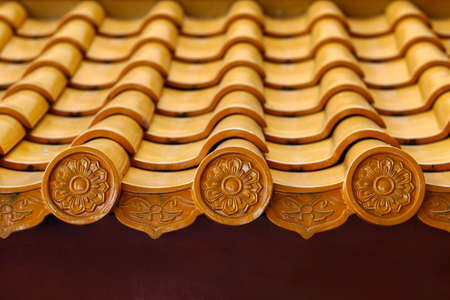 orange roof tiles on buddhist temple with chinese design