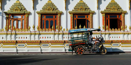 moto taxi in front of a buddhist temple in thailand Sajtókép