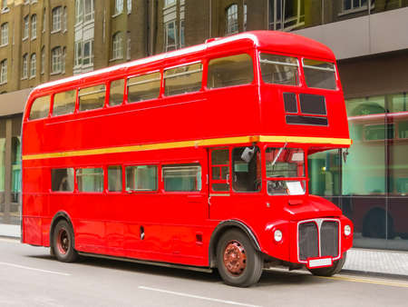 Road Traffic in London. Red Double Decker Bus on the street of London, United Kingdom Stock Photo